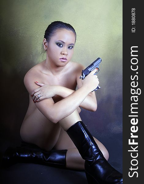 Naked asian girl with gun picture