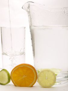 Free Lemon, Lime And Orange With A Jug And A Glass Royalty Free Stock Photo - 18800195