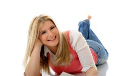 Free Young Casual Smiling Woman Lying On The Floor Stock Photos - 18800773