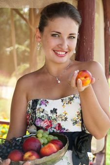 Beautiful Brunette With Fruits Stock Photo