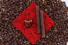 Free Sweets On The Roasted Coffee Beans Royalty Free Stock Photo - 18804705