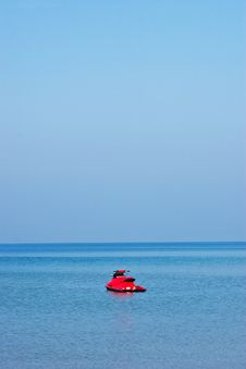Red Jet Ski On Blue Sea Royalty Free Stock Photos