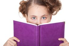 Little Girl Peeping Behind The Book