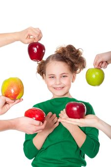 Free Smiling Girl Choose Among Proposed Apples Royalty Free Stock Photography - 18806307