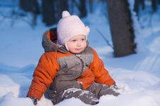 Free Adorable Baby Sit In Snow In Park Looking Forward Stock Photo - 18806560