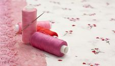Free Pink Spool Of Thread On A Floral Fabric Royalty Free Stock Image - 18807076