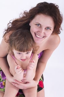 Free Little Girl Sits On Mother S Lap. Stock Image - 18808221