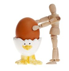 Free Wooden Man And Easter Egg On A Stand. Royalty Free Stock Photos - 18808248