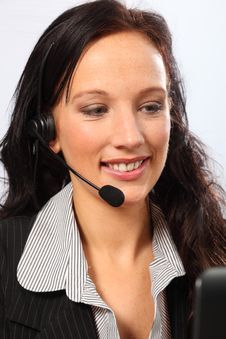 Business Telesales By Smiling Young Woman Stock Images