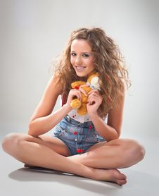 Playful Teen Girl With Teddy Royalty Free Stock Photo