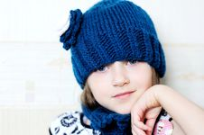 Cute Little Girl In Blue Knitted Hat Royalty Free Stock Photos
