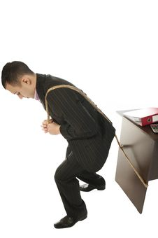 Businessman Pulling A Desk Royalty Free Stock Photography