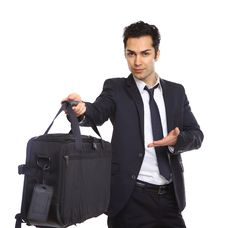 Business Man Handing Over A Briefcase Royalty Free Stock Photo
