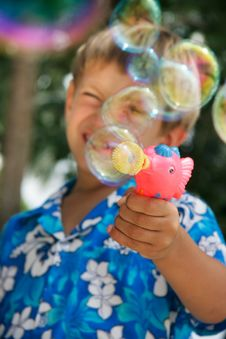 Young Boy Playing With Bubbles Royalty Free Stock Photography