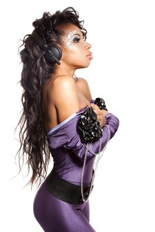 Mulatto Girl DJ Listens Music Royalty Free Stock Images