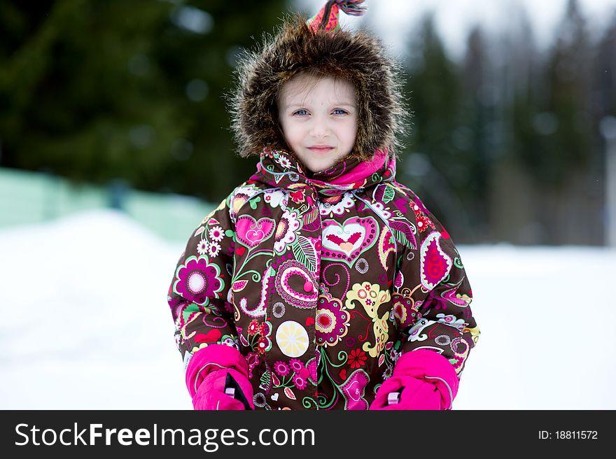 Winter portrait of adorable child girl in jumper