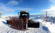 Snow Groomer Vehicle On The Ski Slope Stock Images