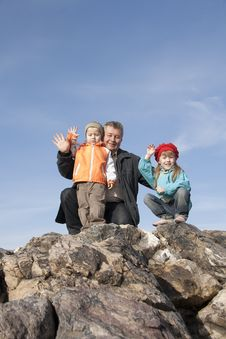 Free Family Have A Rest On A Grie. Royalty Free Stock Photography - 18821127