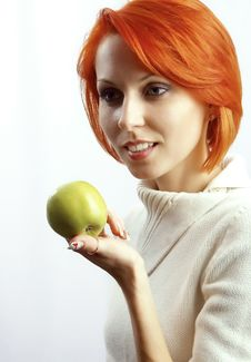Free The Beautiful Woman With An Apple In A Hand Royalty Free Stock Image - 18823646
