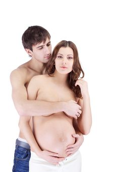 Happy Sensual Couple Embracing With Pregnant Belly Stock Photography