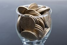 Free Coins In A Glass Royalty Free Stock Photography - 18830347