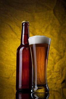 Free Beer In Glass With Bottle On Yellow Stock Image - 18834951