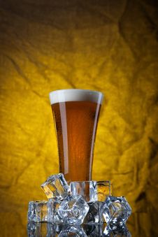 Free Beer In Glass With Ice Cubes On Yellow Royalty Free Stock Image - 18834956