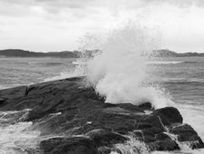 Free Wave Breaking Against Coast Rock Royalty Free Stock Image - 18835426