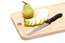 Free Pear And Slices With Knife On Chopping Board Stock Images - 18837354
