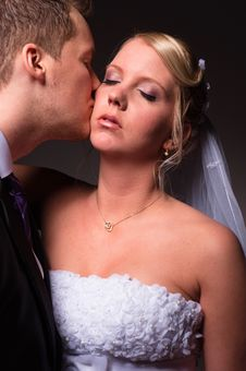 Free Groom Kissing The Bride Stock Images - 18853024