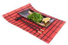 Free Plate With Chuka Salad On A Red Mat Stock Photography - 18853962