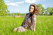 Relaxed  Girl Sitting On Grass In Park - Outdoor