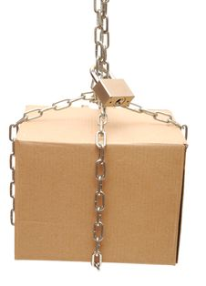 Free Cardboard Box Closed With A Chain And A Lock Stock Photography - 18858502