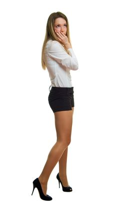 Free Girl In A White Shirt And Black Shorts Royalty Free Stock Photography - 18860667