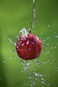 Apple With A Splash Royalty Free Stock Photos