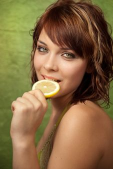 Free Girl Biting Slice Of Lemon Stock Images - 18861804