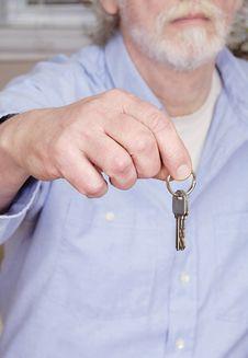 Free Man Holding Keys Royalty Free Stock Photography - 18862317
