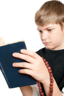 The Child Reads The Bible. Royalty Free Stock Images