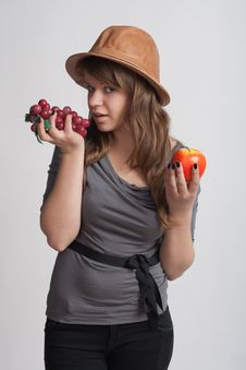 Free Girl With Grapes And Apples In The Hands Of Royalty Free Stock Photos - 18867338