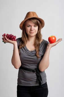 Free Girl With Grapes And Apples In The Hands Of Stock Photography - 18867352