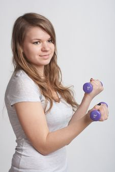 Free Girl With Dumbbells In Hand Royalty Free Stock Images - 18867389