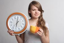 Free Portrait Of A Girl With A Cup And A Clock Royalty Free Stock Images - 18867449