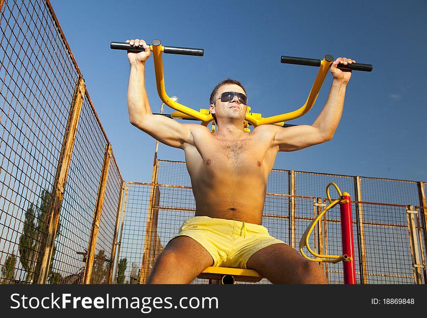 Muscular man doing weightlifting