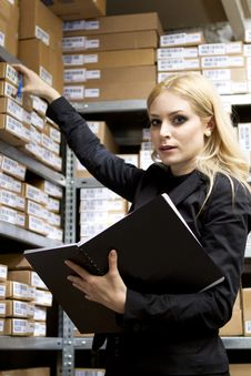 Free Sexy Young Woman Doing Inventory Royalty Free Stock Images - 18872669