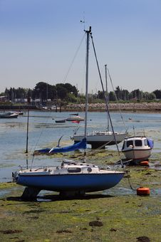 Yachts On The Mud At Low Tide. Stock Photo