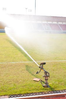 Free Nozzles Are Watering The Field. Royalty Free Stock Photography - 18875187