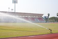 Free Nozzles Are Watering The Field. Royalty Free Stock Images - 18875279