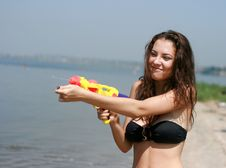 Happy Young Woman Playing With Water Gun Royalty Free Stock Image