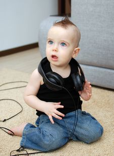 Free Baby And Earphones Royalty Free Stock Photos - 18876098
