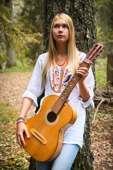 Free Pretty Girl Playing Guitar Stock Photos - 18877443